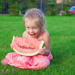 Little girl eating a ripe juicy watermelon in summertime — Stock Photo