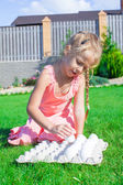 Adorable little girl preparing for Easter with a tray of white eggs — Stockfoto