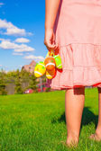 Closeup colorful Easter eggs in the hands of little cute girl — Stock Photo