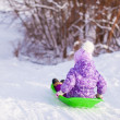 Little cute girl pulls a sled in warm winter day — Stock Photo