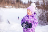 Portrait of Little cute happy girl in the snow sunny winter day — Stock Photo