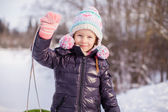 Little adorable happy girl enjoying snow sunny winter day — Stock Photo