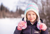 Portrait of little adorable happy girl in the snow sunny winter day — Stock Photo