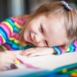 Little cute girl painting with pencils while sitting at her table — Stock Photo #41243867