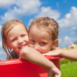 Two adorable little happy girls having fun outdoor on summer day background blue sky — Stock Photo #41244095