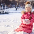Adorable little girl outdoor in the park on cold winter day — Stock Photo #41244349