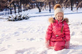 Adorable little girl have fun outdoor on cold winter day — Stock Photo
