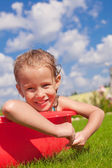 Portrait of smiling charming little girl enjoying her vacation in the pool outdoors — Stock Photo