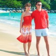 Young romantic couple walking on exotic beach in sunny day — Stock Photo #42375203