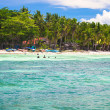Panoramic view of perfect beach with green palms,white sand and turquoise water — Stock Photo