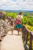 Dad with his daughter walking in tropical park at the Chocolate Hills — Stock Photo