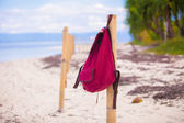 Red backpack on the fence at deserted tropical island — Foto Stock