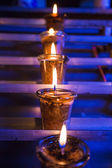 Closeup of burning candles in the Catholic Church — Stockfoto