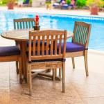 Summer empty open air restaraunt near swimming pool — Stock Photo #43391639