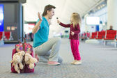 Little adorable girl and young father in the airport — Stock Photo