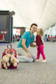 Little adorable girl and young father walking in the airport — Stock Photo