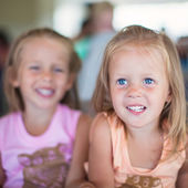 Portrait of two little beautiful blue-eyed girls — Stockfoto