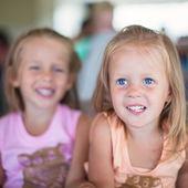 Portrait of two little beautiful blue-eyed girls — Stock Photo