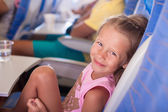 Little smiling happy girl in the airplane — Stock Photo