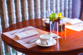 Served table for breakfast in luxury hotel with flowers — Stok fotoğraf