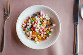 Colorful flakes in a white plate — Stock Photo