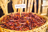 Dried chilis in a large basket — Stock Photo