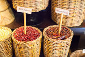 Seeds, beans, pepper and other spices in large baskets — Stock Photo