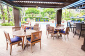 Hotel outdoor cafe with white table and chairs — Stock Photo