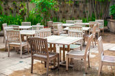 Hotel patio with wooden white furniture — Stock Photo