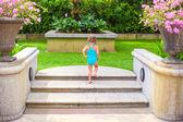 Little girl near open-air pool in luxury resort — Stock Photo