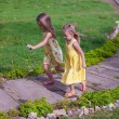 Little adorable girls running in exotic resort — Stock Photo