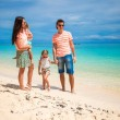 Young beautiful family with two kids on tropical vacation — Stock Photo
