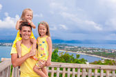 Dad with his daughters at observation deck on the background of beautiful scenery — Stock Photo