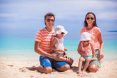 Portrait of a beautiful caucasian family on tropical vacation — Stock Photo