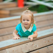 Adorable little girl walking outdoor and having fun in summer park — Stock Photo