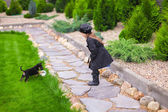 Adorable little girl playing with her puppy outdoor — Стоковое фото