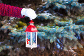 Closeup of a hand holding beautiful vintage Christmas lantern — Stock Photo