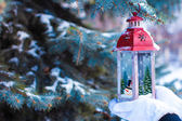 Beautiful red vintage Christmas lantern on warm mittens — Stock Photo