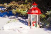 Christmas lantern with snowfall near green fir tree — Stock Photo