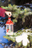 Close up of a hand holding beautiful vintage Christmas lantern — Stock Photo