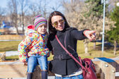Portarit of little cute girl with her mother on sunny day outdoors — 图库照片