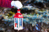 Close up of a hand holding beautiful vintage Christmas lantern — Zdjęcie stockowe
