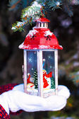 Beautiful red vintage Christmas lantern on warm mittens — Foto Stock