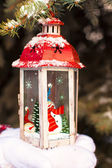 Beautiful vintage Christmas lantern on the palms of young girl — Stock Photo