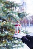 Beautiful red vintage Christmas lantern on warm mittens — Stock Photo