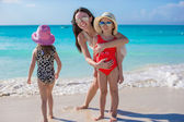 Mother and two little kids at beach on sunny day — Stock Photo