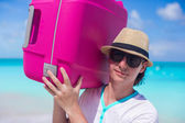 Close-up of a young man carrying his luggage — Stock Photo