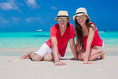 Close up of couple sitting in the heart on tropical white beach — Stock Photo