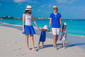Young beautiful family with two kids on caribbean vacation — Stock Photo