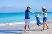 Happy family of three enjoying beach vacation — Stock Photo
